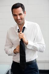 businessman taking off his tie