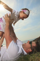 A father and daughter having fun outside