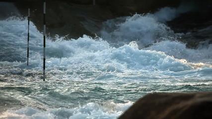 Shot of kayaker blazing through white waters