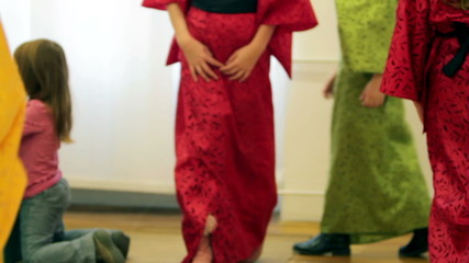 Close up of young girls dressed as japanese old fashioned clothes