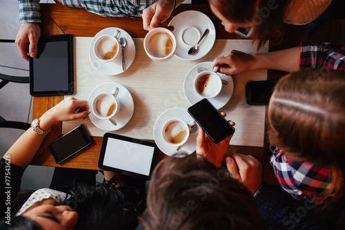 Friends In Cafe Drinking Coffee - 77543626