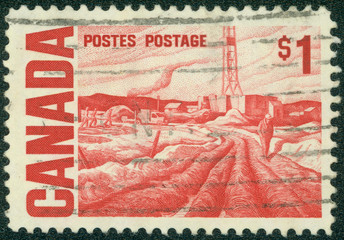 stamp printed in the Canada shows Oilfield near Edmonton