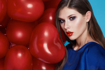 Beautiful sexy brunette woman makeup Valentines day balloons