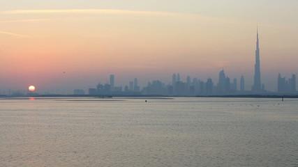 view of Dubai skyscraper at sunset