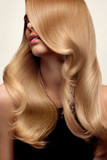 Blond hair. Portrait of beautiful Blonde with Long Wavy Hair. Hi