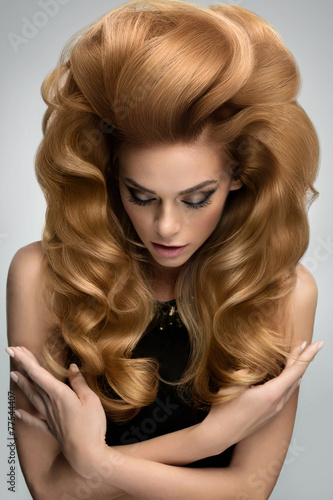 Hair volume.  Portrait of beautiful Blonde with Long Wavy Hair. - 77544407