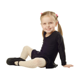 Little Girl dancer sits on White Background