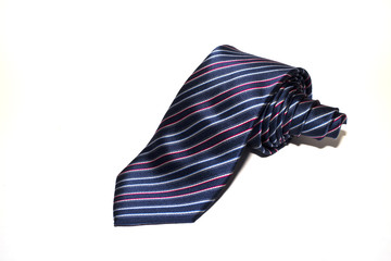 Folded striped necktie on a white background