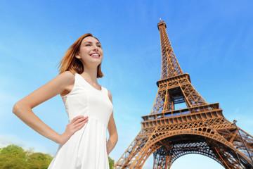 Happy woman tourist in Paris