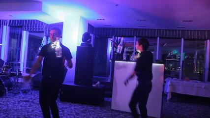 Beautiful bartenders speak to the audience in a nightclub. show