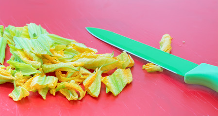 knife and courgette flowers