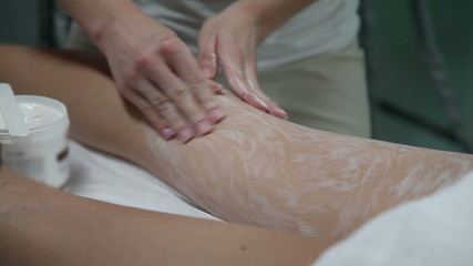 Profesional massaging legs with a special cream