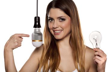 Beautiful business woman advertising a LED bulb