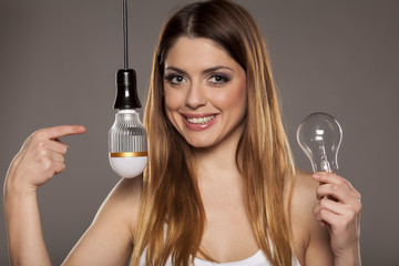 Beautiful business woman advertising a LED bulb