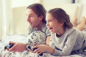 Child playing video game with father