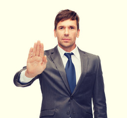 attractive buisnessman making stop gesture