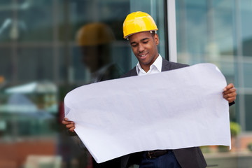 portrait of construction engineer with blueprints