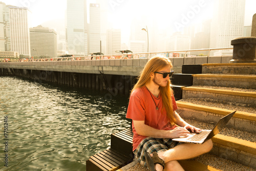 poster of Hispter working on a Pier with bright light