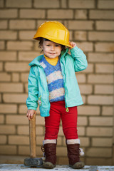 cute girl with helmet working on construction