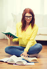 smiling student girl reading books at home