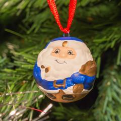 blue santa claus shaped ball decoration on christmas tree
