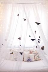Beautiful tropical butterflies on white canopy. Sleep mood.