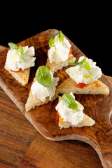 Spanish food tapas. Toasted bread with fresh cheese