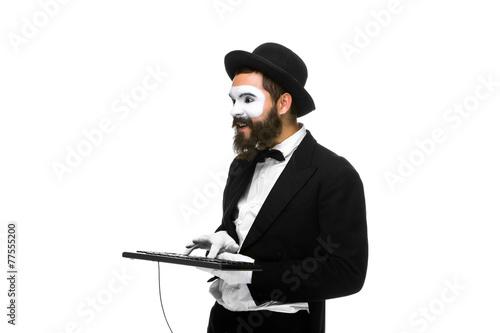 Poster mime as a businessman holdinga keyboard