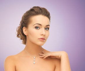 beautiful young woman with shiny diamond pendant