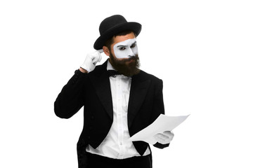 pensive mime as a businessman reading the list of paper