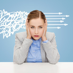 stressed woman covering her ears with hands