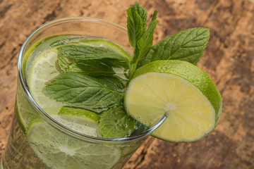 drink decorated with lime and mint leaves