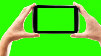 hands and phone on a green screen