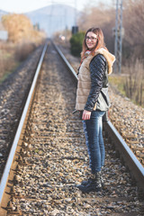 Beautiful Young Woman Standing on Railway Tracks. The Railroad i