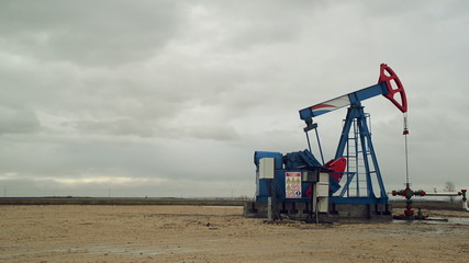 Pumpjack Oil Pump operating on natural gas in the oil field