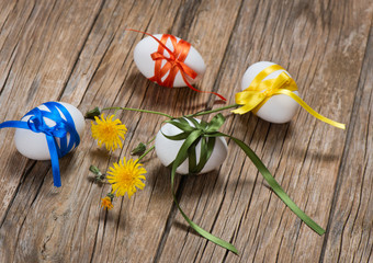 easter eggs with color ribbons