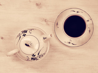 Vintage teapot and teacup. Top view.