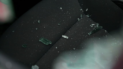 Shattered car window glass on the seat