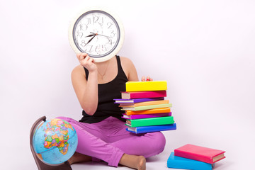 Girl with books, globe and clock
