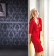 Elegant woman leaning against the door