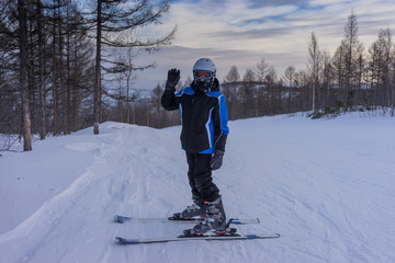 Waving farewall on the ski trail