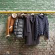 Men's trendy clothing on hangers - 77562634