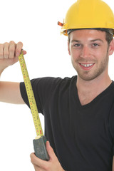 A young carpenter in front of a white background