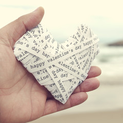 heart made-up with paper strips with the text happy valentines d