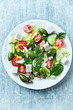 Mediterranean-style salad with whole green olives and feta