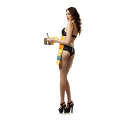 sexy girl in lingerie having fun with saucepan