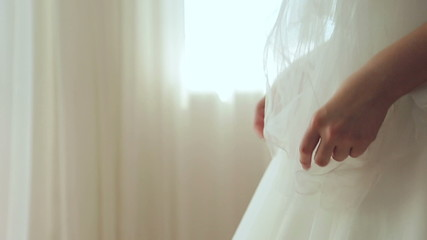 Bride is waiting for the groom in the room, close-up of hands