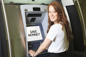 A student using a ATM machine at school