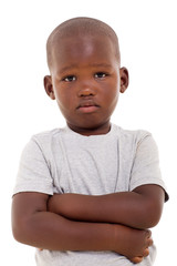 unhappy little african boy with arms crossed
