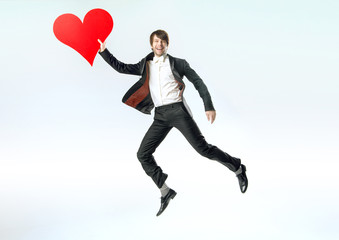 Cheerful jumping man witha big heart